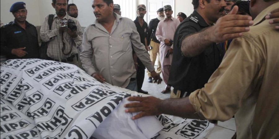 Karachi: 15th May - Policemen standing near the body of former jail superintendent of Hyderabad police  Ejaz Haider who was killed when gunmen opened fire on his car near Karachi's Pehlwan Goth area on  Friday. - DNA Photo by Suleman Khan
