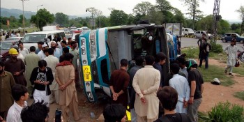 Islamabad: 17th May - A passenger bus overturned on its side near Lake View Point caused injuries to  many passengers on Sunday. - DNA Photo by Shahid Raju