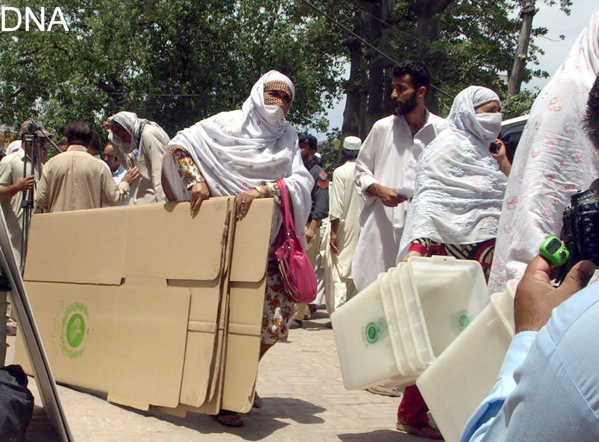 Peshawar: 29th May - Lady Presiding  Officers get ballet boxes and  other polling material for their respective pooling booths at Govt  High School No 1, on Thursday. – DNA Photo by Saidy