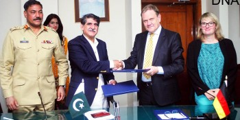 Islamabad: 22nd May - Secretary Economic Affairs Division Mr. Muhammad Saleem Sethi, the Director of the KFW Office Pakistan, KFW Development Bank Mr. Wolf Gang Moellers exchanging documents after signing an MoU in Islamabad. Secretary Health of AJ&K, Brig. Tariq Hussain and Head of Economic and Development Cooperation, German Embassy, Ms. Almut Knop are also seen in the picture.  DNA Photo
