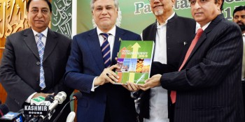 Islamabad: 2nd June - Finance Minister Senator Mohammad Ishaq Dar displays copy of Economic Survey  2015-16 to the media at the launching ceremony held in Islamabad on Thursday. Parliamentary Secretary  (Finance), Rana Mohammad Afzal, Secretary Finance, Dr. Waqar Masood Khan, Economic Advisor, Syed  Ejaz Wasti, others are also present.- DNA Photo