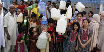 Rawalpindi: 7th June - Residents of Dheri Hassanabad carrying empty jerry cans hold a protest  demo  against water shortage, in front of a closed water filtration plant on Tuesday. - DNA Photo Parvez Iqbal