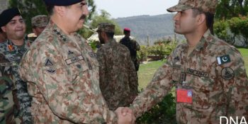 KURRAM AGENCY, AUG 23: Chief of Army Staff General Raheel Sharif sakes hand with an officer duirng his visit to Thall, Kurram  on Tuesday. DNA PHOTO