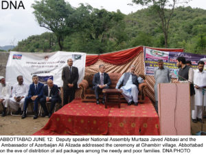 ABBOTTABAD JUNE 12:  Deputy speaker National Assembly Murtaza Javed Abbasi and the  Ambassador of Azerbaijan Ali Alizada addressed the ceremony at Ghambirr village, Abbottabad on the eve of distribtion of aid packages among the needy and poor families. DNA PHOTO