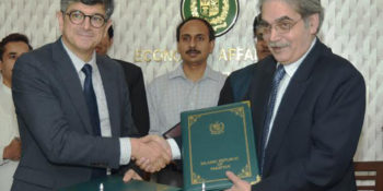 ISLAMABAD, JUN 22: Tariq Mahmood PASHA, Secretary of Economic Affairs Division and René Consolo, Chargé d'Affaire Embassy of France exchange after signing loan agreement in Islamabad.=DNA PHOTO