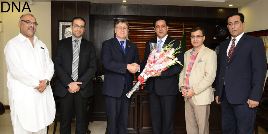 RAWALPINDI, JUL 25: President RCCI, Raja Amer Iqbal, presents a bouquet to High Commissioner of Canada, Perry Calderwood at Chamber House.=DNA PHOTO