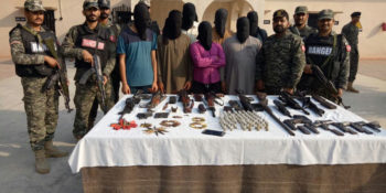 LAHORE, SEPT 30: Ranger personnel display sized weapons and suspects in front of media, on Saturday.=DNA PHOTO