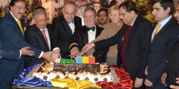 ISLAMABAD, NOV 30: Federal Minister for Defence Production, Rana Tanveer Hussain, Ambassador of Romania, Nicolae Gola and others cutting cake to celebrate National Day of Romania.=DNA PHOTO