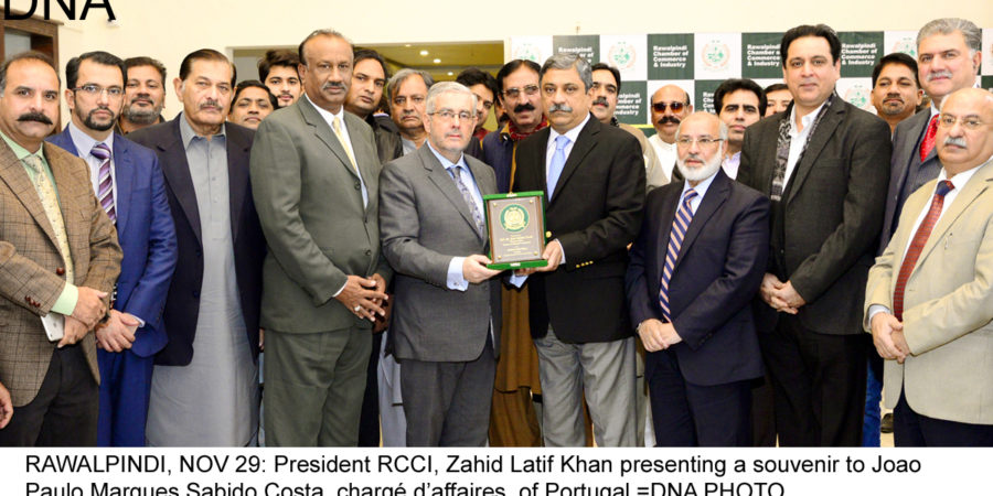 RAWALPINDI, NOV 29: President RCCI, Zahid Latif Khan presenting a souvenir to Joao Paulo Marques Sabido Costa, chargé d'affaires, of Portugal.=DNA PHOTO