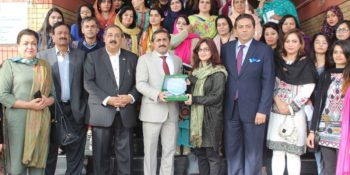 ISLAMABAD, DEC 13: President ICCI, Sheikh Amir Waheed presenting a shield to Sadaf Raza, Director Ideas for Life Trust during her visit to Chamber House.=DNA PHOTO
