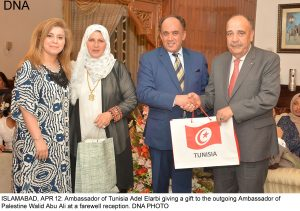 ISLAMABAD, APR 12: Ambassador of Tunisia Adel Elarbi giving a gift to the outgoing Ambassador of Palestine Walid Abu Ali at a farewell reception. DNA PHOTO