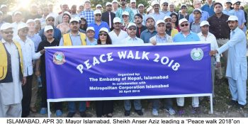 "ISLAMABAD, APR 30: Mayor Islamabad, Sheikh Anser Aziz leading a ""Peace walk 2018""on the eve of 2562th Anniversary of Shakyamuni Gautam Buddha, the apostle of peace, arrange by Embassy of Nepal at F-9 Park.=DNA PHOTO"