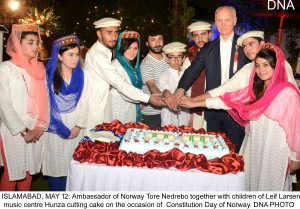 ISLAMABAD, MAY 12: Ambassador of Norway Tore Nedrebo together with children of Leif Larsen music centre Hunza cutting cake on the occasion of Constitution Day of Norway. DNA PHOTO