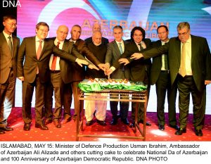 ISLAMABAD, MAY 15: Minister of Defence Production Usman Ibrahim, Ambassador of Azerbaijan Ali Alizade and others cutting cake to celebrate National Da of Azerbaijan and 100 Anniversary of Azerbaijan Democratic Republic. DNA PHOTO