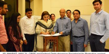 ISLAMABAD, MAY 31: CRSS and Federal Ombudsperson Secretariat for Protection against Harassment (FOSPAH) signing a MoU to work on harassment against women.=DNA PHOTO