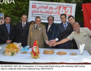 ISLAMABAD, MAY 08: Ambassador of Tunisia Adel Elarbi along with embassy staff cutting cake to celebrate Diplomacy National Day. DNA PHOTO