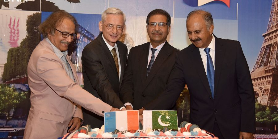 ISLAMABA,D JULY 15: Federal Minister for Law, Justice & Parliamentary Affairs and Information Minister Syed Ali Zafar, Ambassador of France Marc Barety and others cutting cake to celebrate National Day of France. DNA PHOTO