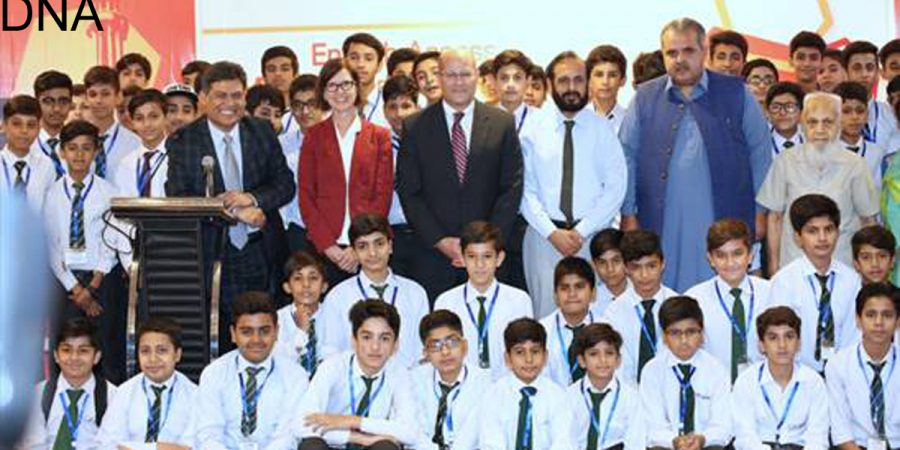 ISLAMABAD, JUL 11: American Embassy's Chargé d'Affaires, John Hoover in a group photo with students at the launch of two English language programs for youth in Islamabad.=DNA PHOTO