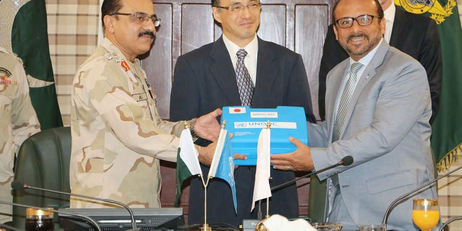 RAWALPINDI, SEPT 13: Brig. Mr. Cesar Guedes, the UNODC Country Office Representative in Pakistan  giving drug identification kits to Sheikh Ali Muhammad, Chief of Staff, ANF on Thursday. DNA