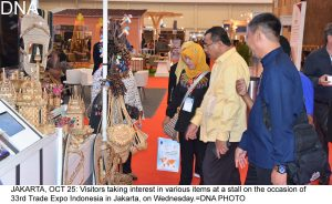 JAKARTA, OCT 25: Visitors taking interest in various items at a stall on the occasion of 33rd Trade Expo Indonesia in Jakarta, on Wednesday.=DNA PHOTO