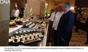 ISLAMABAD, OCT 20: Visitors taking interest in various cuisine displayed during a Hungarian food festival, on Saturday.=DNA PHOTO