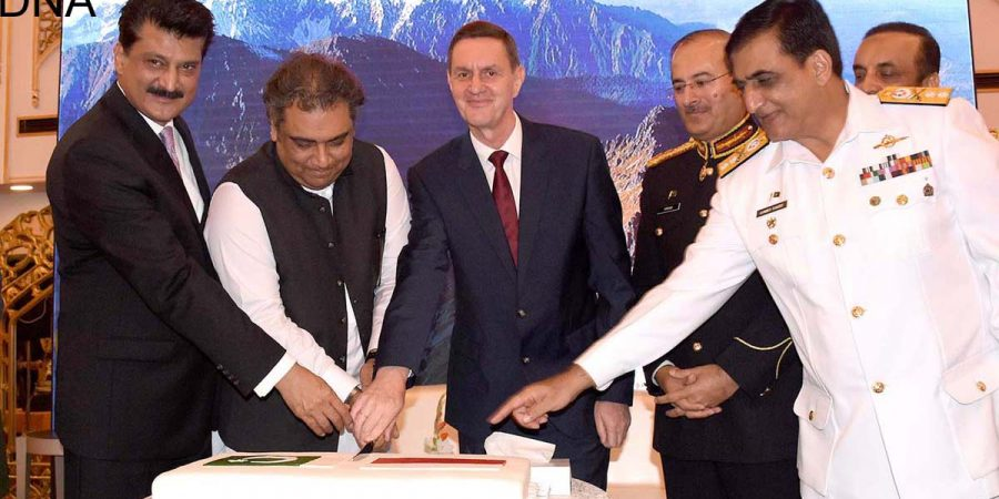 ISLAMABAD, NOV 13: Federal Minister for Maritime Affairs, Ali Zaidi, Ambassador of Poland, Piotr Opalinski and others cutting cake to celebrate the Centenary of Regaining Independence by the Republic of Poland and the Polish Armed Forces day.=DNA PHOTO