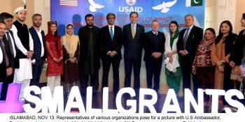 ISLAMABAD, NOV 13: Representatives of various organizations pose for a picture with U.S Ambassador, Paul Jones, during an event held to highlight the impact of U.S. government grants on Pakistani communities.=DNA PHOTO