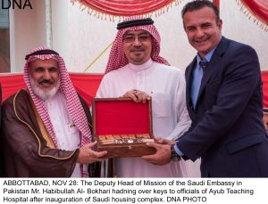 ABBOTTABAD, NOV 28: The Deputy Head of Mission of the Saudi Embassy in  Pakistan Mr. Habibullah Al- Bokhari hadning over keys to officials of Ayub Teaching Hospital after inauguration of Saudi housing complex. DNA PHOTO