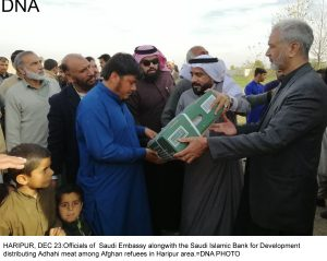 HARIPUR, DEC 23:Officials of  Saudi Embassy alongwith the Saudi Islamic Bank for Development  distributing Adhahi meat among Afghan refuees in Haripur area.=DNA PHOTO