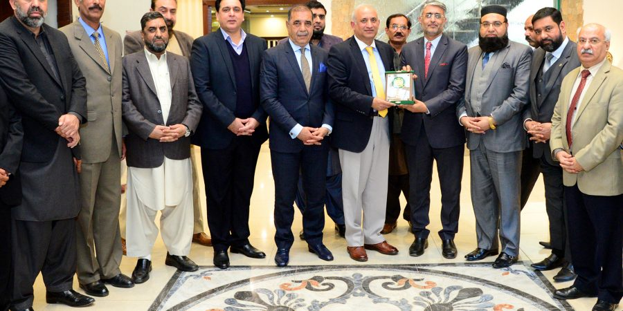 RAWALPINDI, FEB 11: President RCCI Malik Shahid Saleem presenting a shield to Chairman Borad of Investment Haroon Sharif on Monday. DNA PHOTO