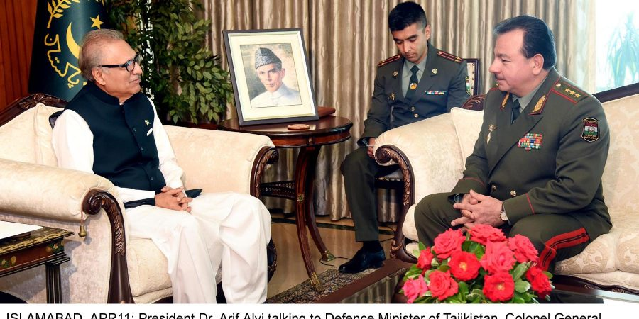 ISLAMABAD, APR11: President Dr. Arif Alvi talking to Defence Minister of Tajikistan, Colonel General  Sherali Mirzo, who called  on him in Islamabad .DNA
