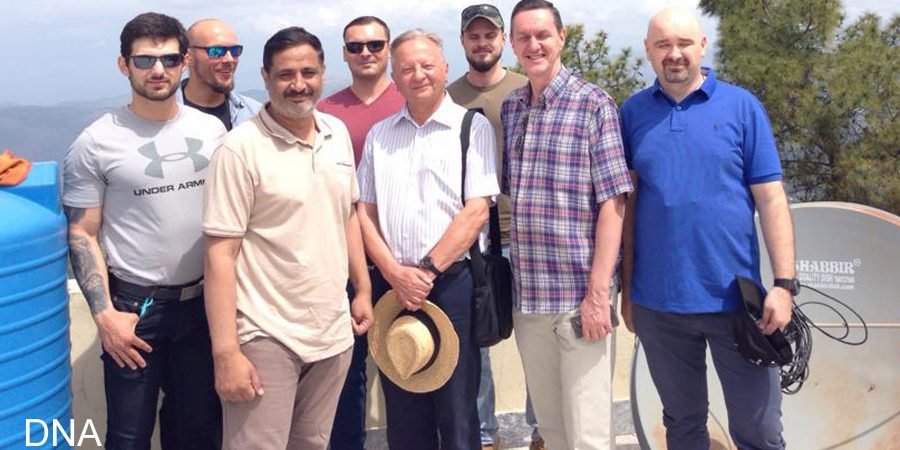 ISLAMABAD, APR 14: Diplomats from various countries posing fora group picture after planting saplings at Yaldram Shooting Range Pir Sohawa. DNA PHOTO