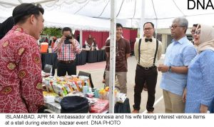 ISLAMABAD, APR 14: Ambassador of Indonesia and his wife taking interest various items at a stall during election bazaar event. DNA PHOTO
