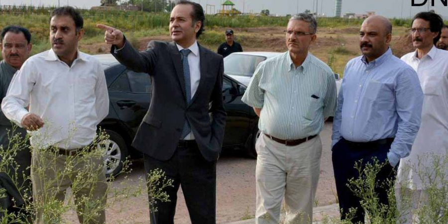ISLAMABAD, JUN 17: Chairman CDA, Amer Ali Ahmed inspecting developmental work of Park enclave, on Monday.=DNA PHOTO