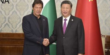 BISHKEK, JUN 14: Prime Minister Imran Khan shakes hand with Chinese President Xi Jinping on the sidelines of SCO Council of Heads of State summit in Bishkek.=DNA PHOTO