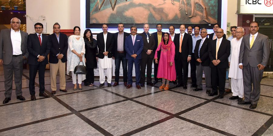 ISLAMABAD, JUL 12: Members of business community and Islamabad Stock Exchange in a group photo on the occasion of farewell lunch hosted by Zahid Latif Khan Chairman ISE for outgoing US Consul General Josh Glazeroff.=DNA PHOTO