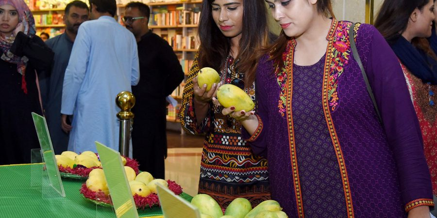 ISLAMABAD, JUL 26: Mango lovers taking interest in various kinds of mangoes during Mango Festival at Centaurus Mall, on Friday.=DNA PHOTO