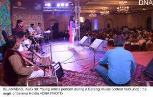 ISLAMABAD, AUG 30: Young artists perform during a Sarangi music contest held under the aegis of Serena Hotels.=DNA PHOTO