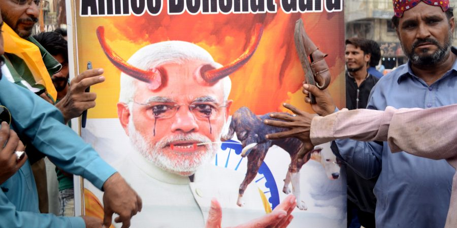 HYDERABAD, AUG 15: Members of civil society burning Indian PM portrant  during black day protest. DNA