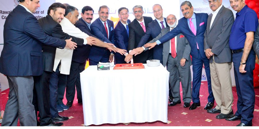 Chinese ambassador Yao Jing along with office bearers of RCCI perform cake cutting ceremony to mark 70th anniversary of People's Republic of China
