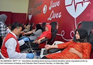 ISLAMABAD, SEPT 14: Volunteers donating blood during a blood donation camp orgnaised jointly by the Indonesian embassy and Pakistan Red Crescent Society, on Saturday. DNA