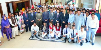 RCCI Preisdent Malki Shahid Saleem in a group photo with students of universities at the inaugural session of firts RCCI Youth Club meeting at Chamber House here on Thursday
