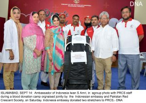 ISLAMABAD, SEPT 14: Ambassador of Indonesia Iwan S Amri, in agroup photo with PRCS staff during a blood donation camp orgnaised jointly by the Indonesian embassy and Pakistan Red Crescent Society, on Saturday. Indonesia embassy donated two stretchers to PRCS,- DNA