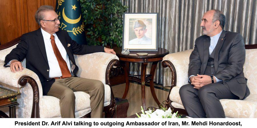 President Dr. Arif Alvi talking to outgoing Ambassador of Iran, Mr. Mehdi Honardoost, who paid a farewell call on him at the Aiwan-e-Sadr, Islamabad on November 22, 2019.