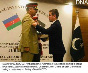 ISLAMABAD, NOV 22: Ambassador of Azerbaijan, Ali Alizada pinning a badge to General Zubair Mahmood Hayat, Chairman Joint Chiefs of Staff Committee during a ceremony on Friday.=DNA PHOTO