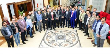 RCCI President Saboor Malik in a group photo with 21 member Chinese delegation who visited RCCI here on Monday