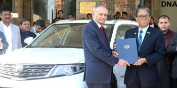 ISLAMABAD, DEC 16: High Commissioner of Malaysia Ikran Mohammad Ibrahim handing over car papers to PM Advisor Razzaq Daowd. The Malaysian made car X70 is gifted to PM Imran Khan by Malaysian Prime Minister Mahathir Mohammad. DNA PHOTO