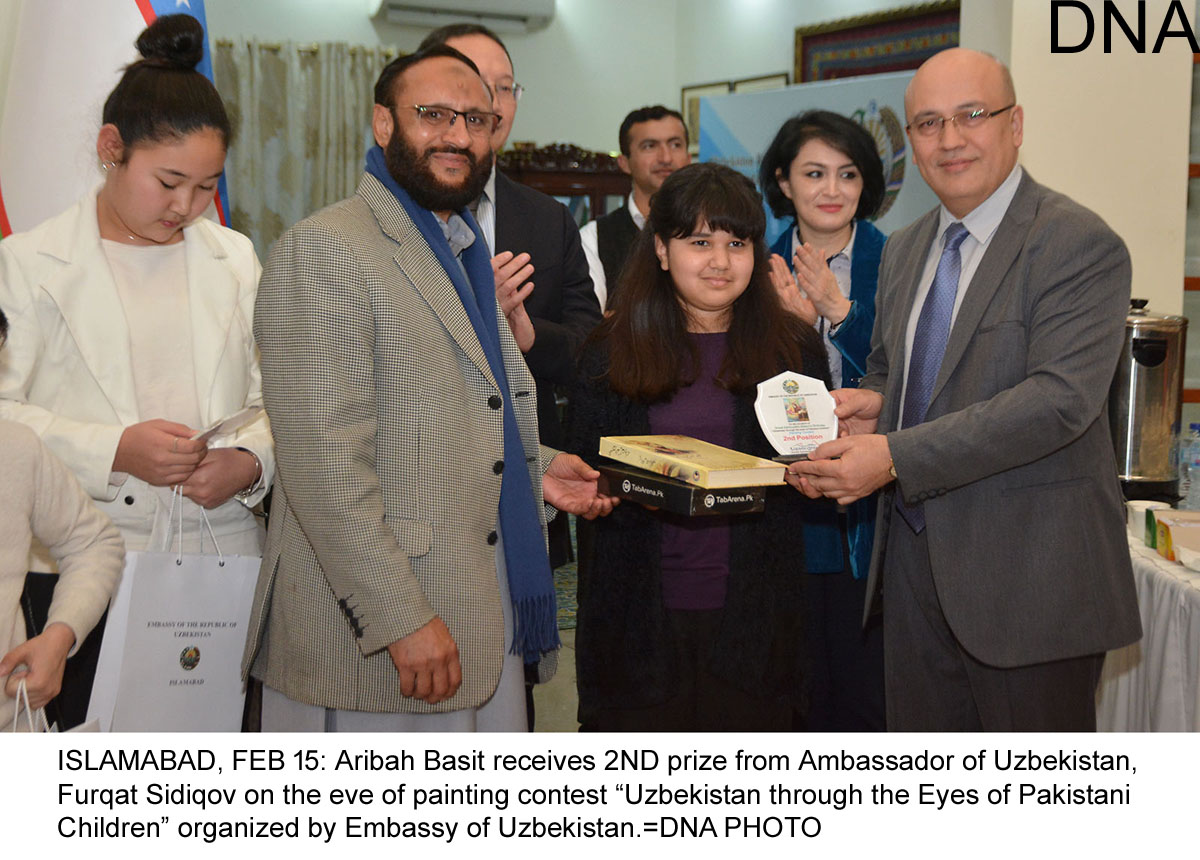 "ISLAMABAD, FEB 15: Aribah Basit receives 2ND prize from Ambassador of Uzbekistan, Furqat Sidiqov on the eve of painting contest ""Uzbekistan through the Eyes of Pakistani Children"" organized by Embassy of Uzbekistan.=DNA PHOTO"