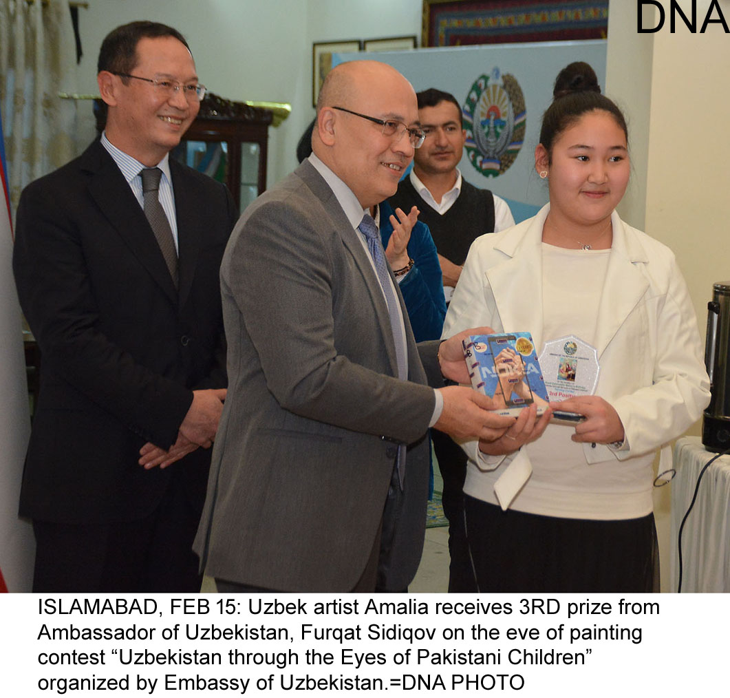 "ISLAMABAD, FEB 15: Uzbek artist Amalia receives 3RD prize from Ambassador of Uzbekistan, Furqat Sidiqov on the eve of painting contest ""Uzbekistan through the Eyes of Pakistani Children"" organized by Embassy of Uzbekistan.=DNA PHOTO"